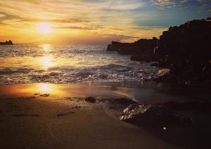 Закат на пляже Playa de la Arena